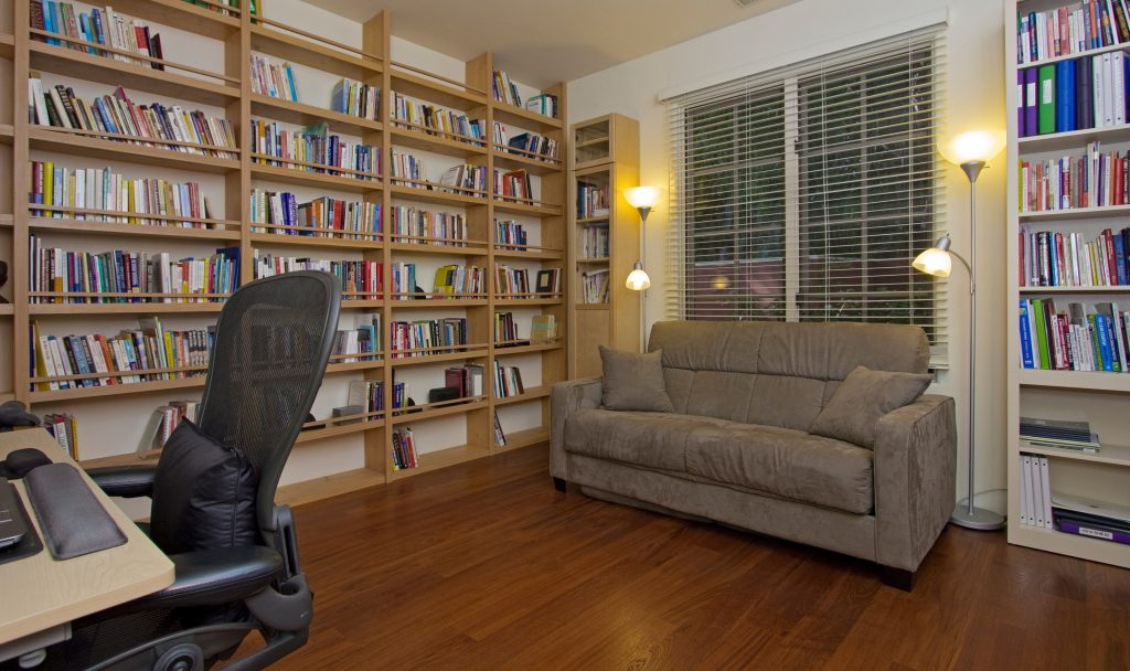 village properties office, real estate office, santa barbara office, bookshelf,