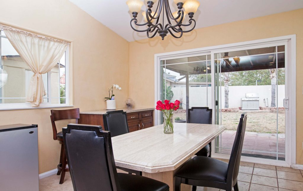 dining room table, roses, flowers, chandelier
