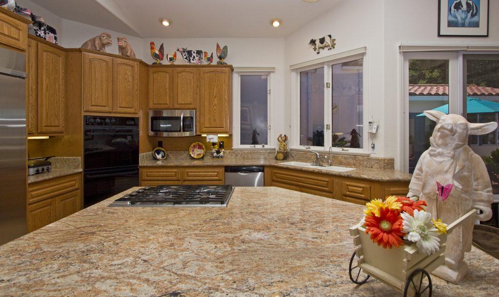 custom kitchen design, architecture, santa barbara, santa barbara real estate, santa barbara home kitchen, stove and granite counters.