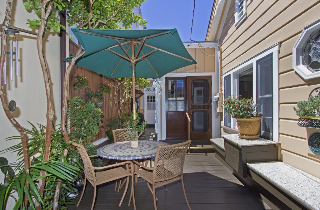patio, outdoor, umbrella, table, wind chimes, potted plants, santa barbara, montecito, real estate
