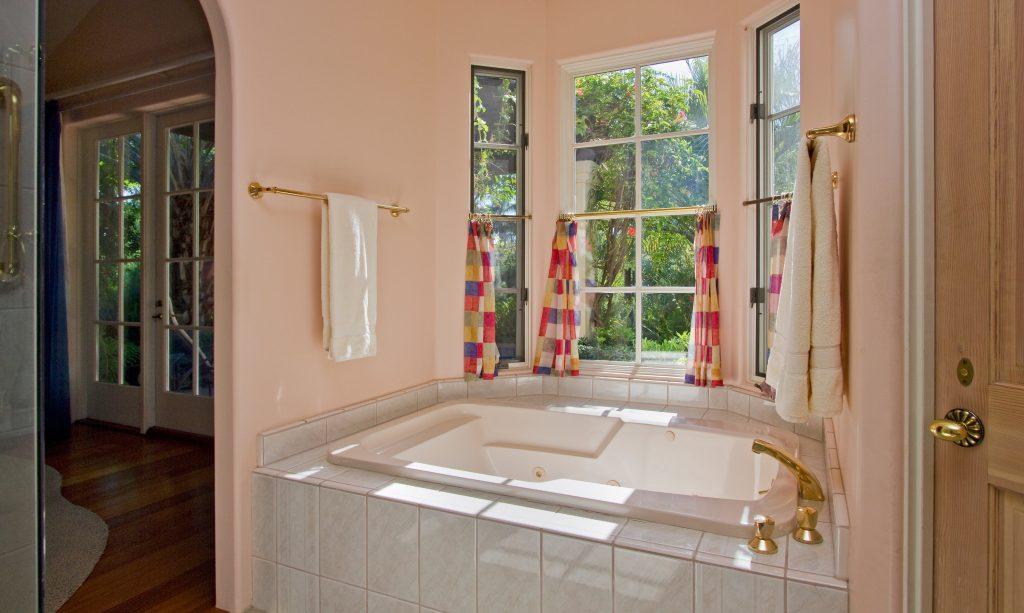 large windows over master bathroom bathtub