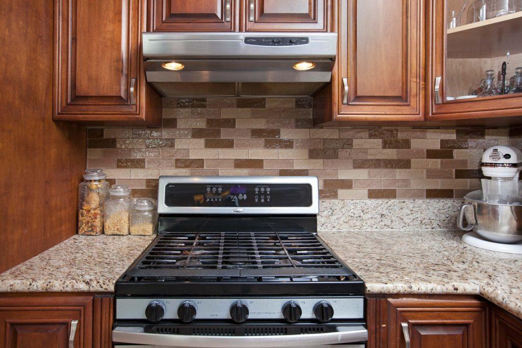 stove, wood cabinets